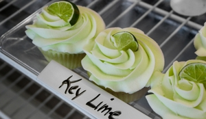 3 key lime cupcakes on white rack
