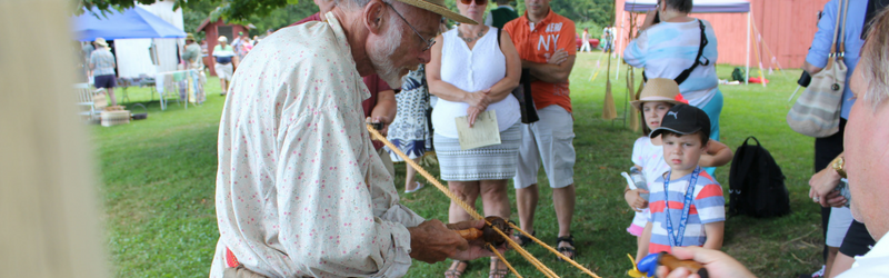 old man making rope