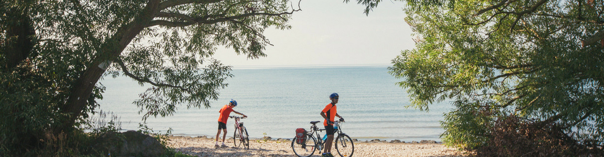 Two cyclists at beach with bikes