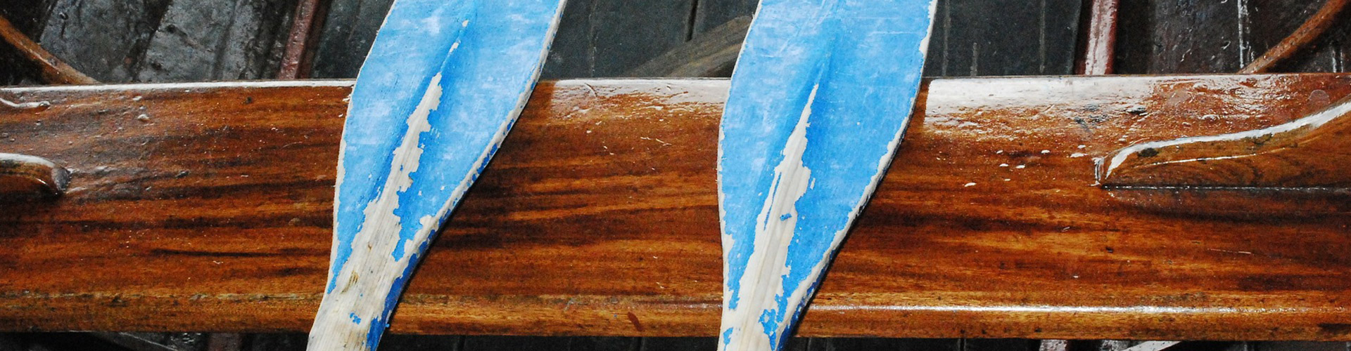 Two oars on seat of canoe